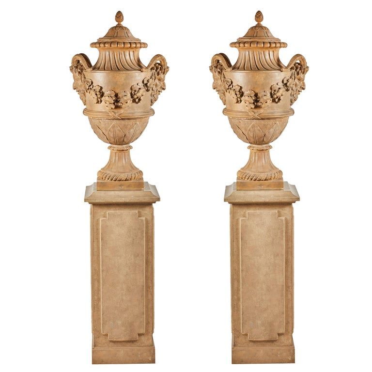 Terracotta urns on pedestals from the collection of Karl Lagerfeld, 18th century, offered by Timothy Corrigan Antiques