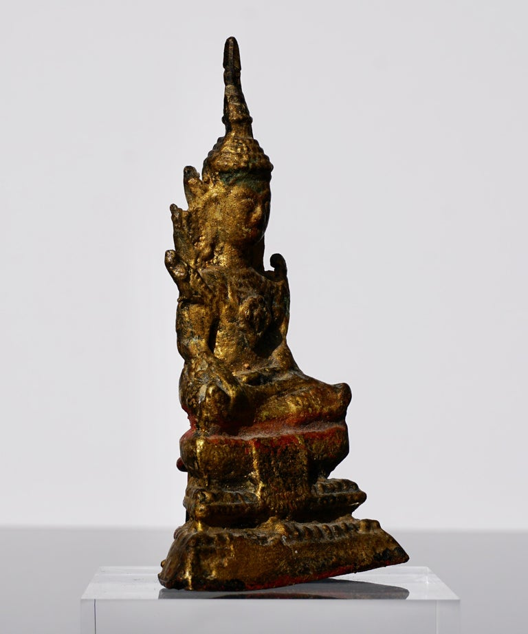 A small and delightful gilt gold bronze Buddha from Thailand.  Measures: Height 4.75 inches (12 cm) Width 2.7 inches (7 cm) Depth 1.5 inches (4 cm).