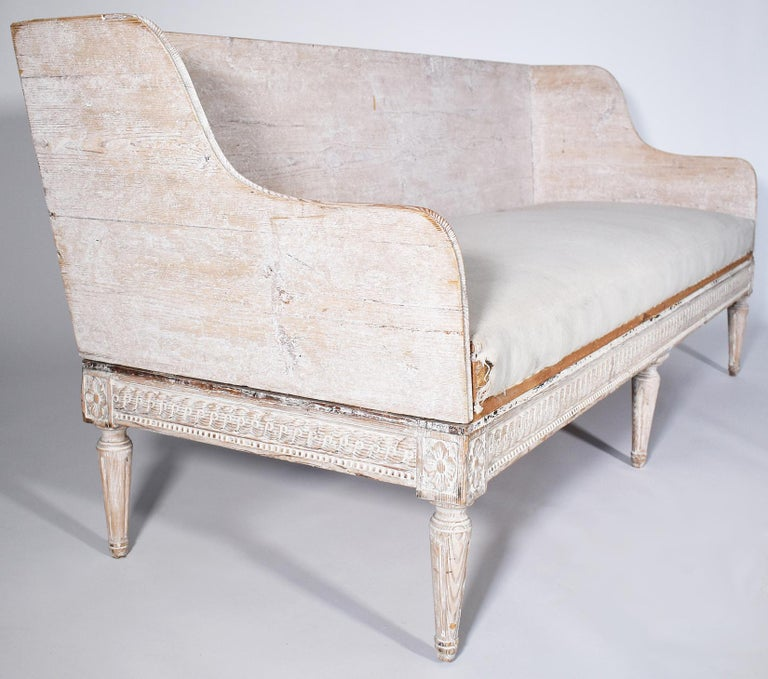 Hand carved with elegant lines and pale patina on this 18th century Swedish Trag sofa. Needs to be reupholstered but it is a simply stunning piece.