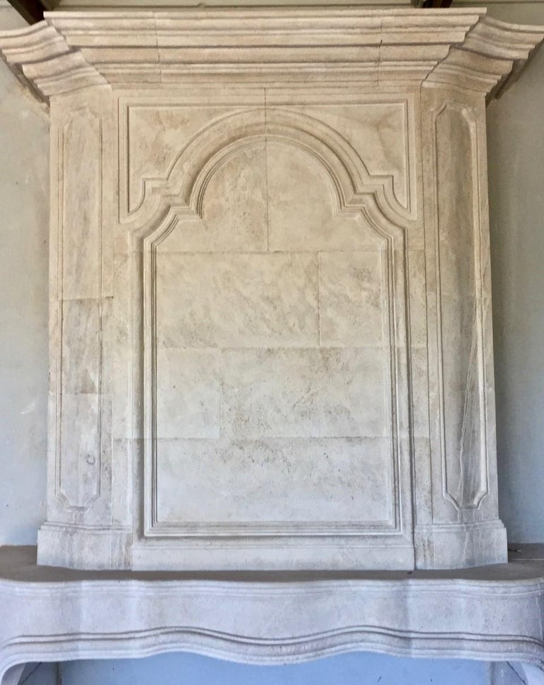 A perfect 18th century limestone fireplace mantel Trumeau reedition. Elegant an ideal in almost any home.