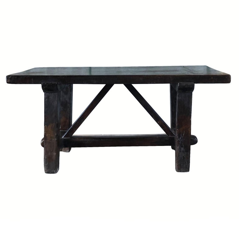 An antique Tuscan kitchen work table made of dark waxed walnut, enhanced by detailed wood cavings. The hand carved farm table is in good condition. Wear consistent with age and use, circa 1760, Tuscany, Italy.