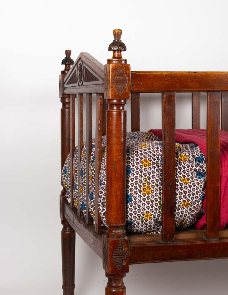 18th century baby bed in walnut with its mattress and zinc interior to install a floral decoration when the baby is growing. Measures: H 84cm, W 113cm, D 58cm.