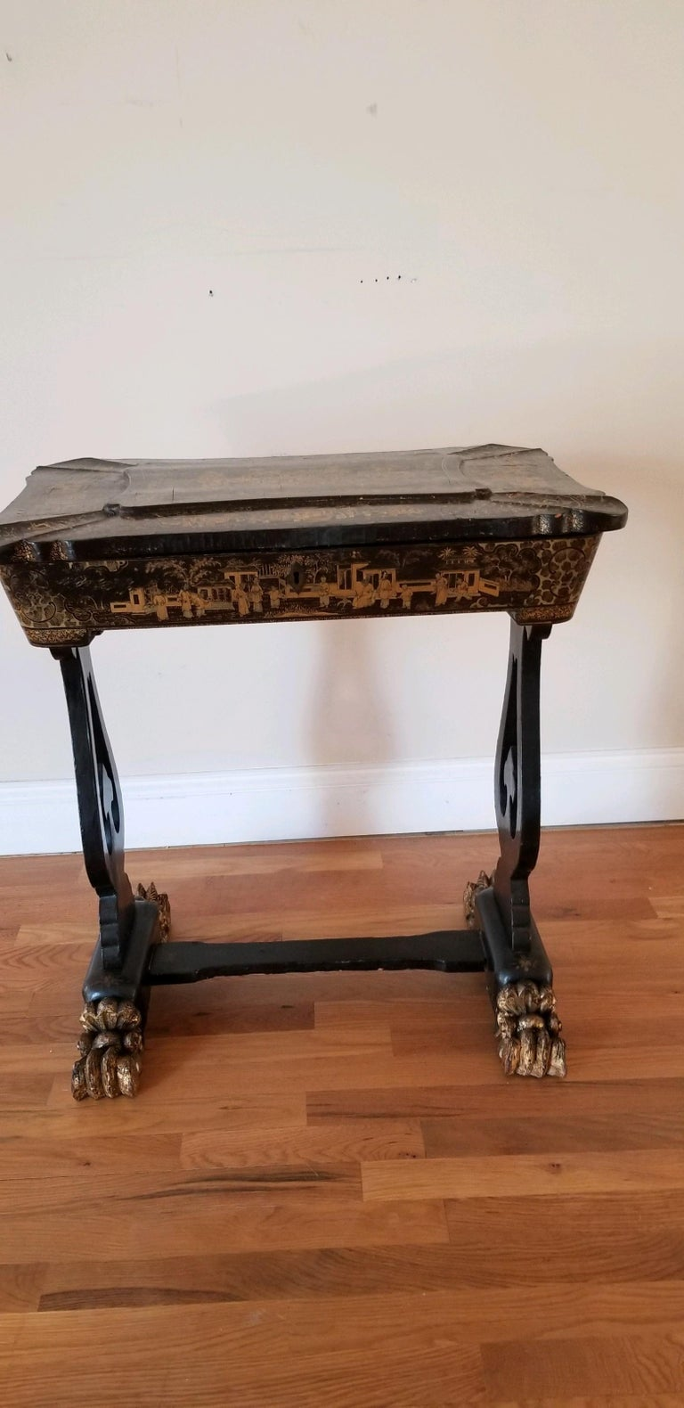 This is a rarity. An 18th early-19th century chinoiserie sewing table of exquisite form. It is the quintessential refinement for the lady's parlor of the period. Chinoiserie was all the rage as the markets were opened up for tea trading then