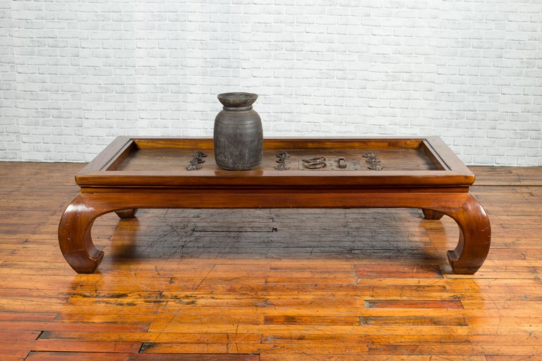 A pair of 18th or 19th century elm doors with iron hardware, fashion into a large Ming style coffee table. Created in China during the 18th or 19th century, this pair of elm doors, fitted with good iron hardware, were transformed into a coffee
