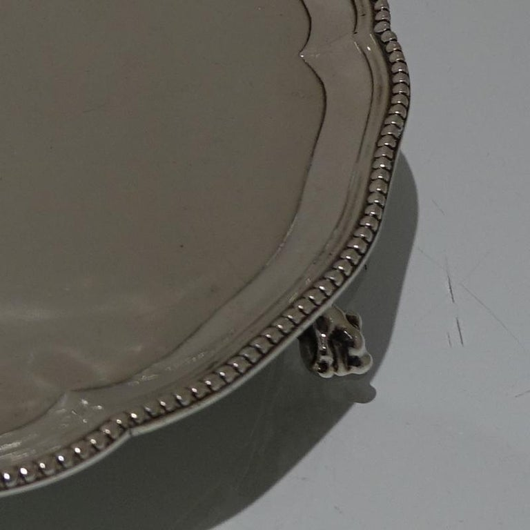 A stylish 18th century shaped circular salver decorated with an outer bead border and a contemporary inner armorial for importance. The salver sits on three stylish ball and claw feet.     Weight: 12.15 troy ounces/378 grams  Measures: