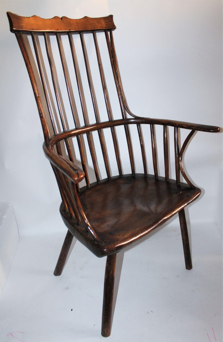 18th century English extended arm Windsor chair and a high back and fantastic patina. The condition is very good and such great form. This is such a rare and fantastic form.