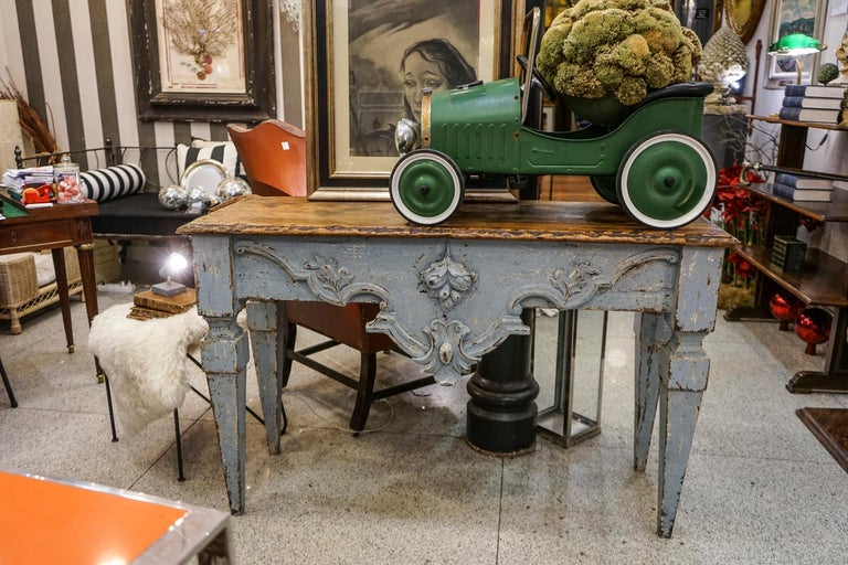 One of a kind Luis XVI provenzal French wooden carved console table hand- painted in sky blue . Top in pine wood ant the rest of the console in hand-painted walnut.Frontal carved with a blazon , acorns and volutes. leg in estipitate way.  A