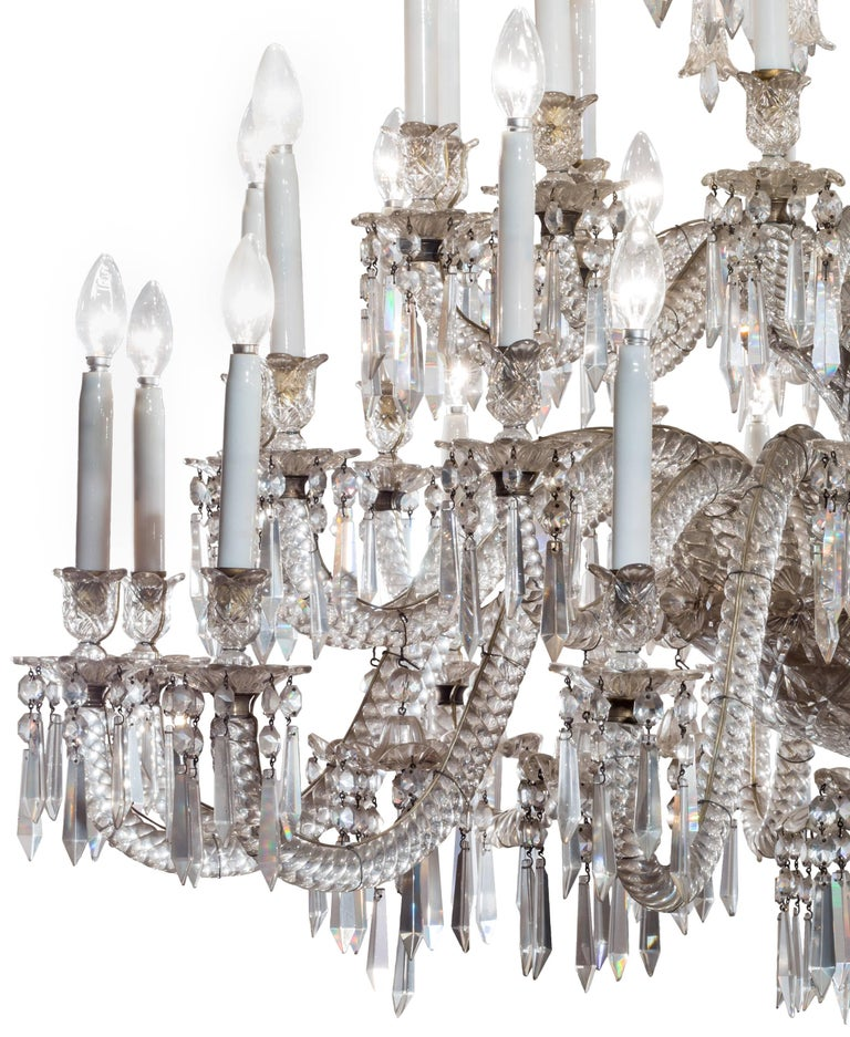 A grand 19th century French Baccarat crystal 36 light, triple-tier chandelier. Large, at over one meter high and wide, a very dramatic piece. Originally meant for use with candles, the chandelier was electrified at some point (carefully installed
