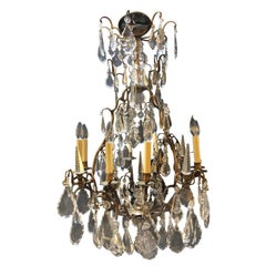 19/20 th Century 8-Light 12-Arm Bronze and Multifaceted Cut Crystal Chandelier