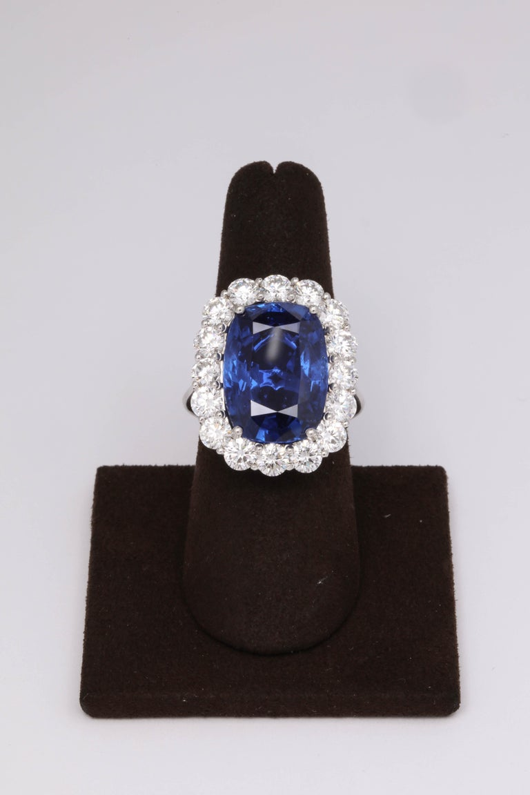 An INCREDIBLE ring!    A RARE find!  Certified 19.19 carat Ceylon Natural No Heat Blue Sapphire with exquisite color and brilliance.   4 carats of round brilliant cut diamonds   Set in platinum   The ring is currently a size 6.5 but can easily be
