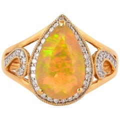 1.9 Carat Ethiopian Opal with Diamond Ring in 18 Karat Yellow Gold