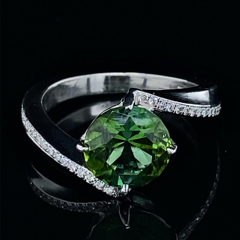 Contemporary 1.9 Carat Green Tourmaline Bypass Ring in Platinum Accented with Tiny Diamonds For Sale