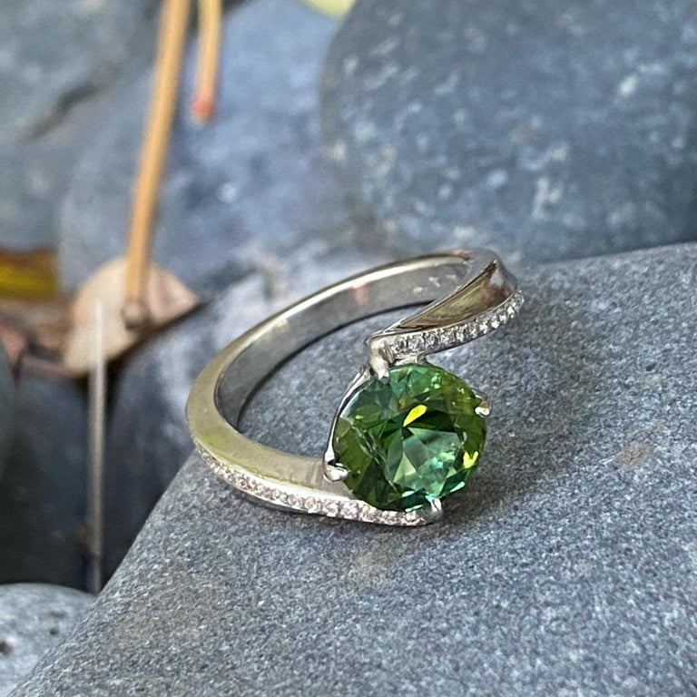 Round Cut 1.9 Carat Green Tourmaline Bypass Ring in Platinum Accented with Tiny Diamonds For Sale