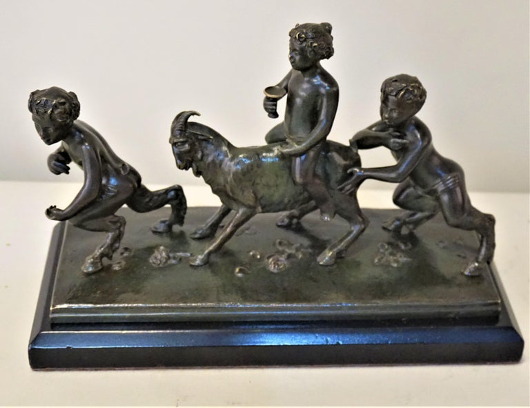 19th century bronze in dark black green patina with the marble base.