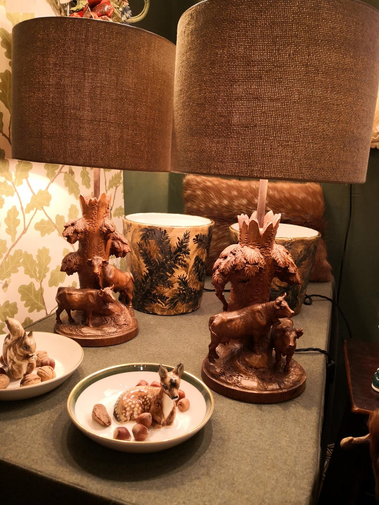 Pair of charming table lamps made of a hand-carved piece of basswood England end of 19th century. The lamp bases are hand carved with cows from one piece of wood in the autentic style of the 19th century. Very detailed hand-carved cows and leaves in