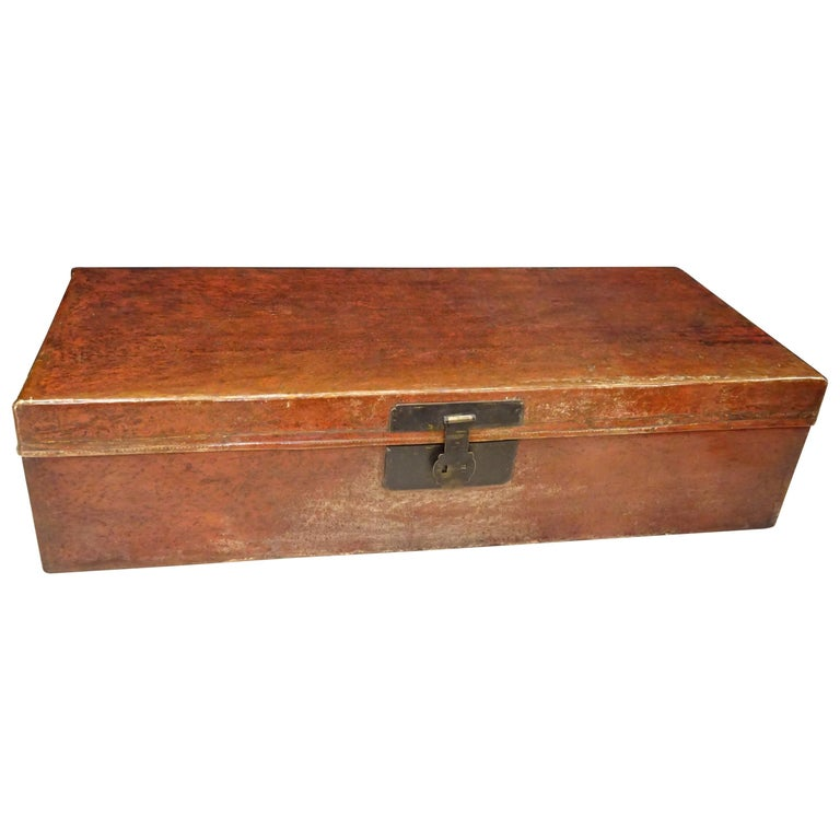 Amazing large pigskin Chinese red lacquer and bronze chest, late 19th century Lacquered wooden chest with handles in bronze as well as the lock and hinges. Interior lined with cobalt blue tinted linen. These pieces were used for storage and