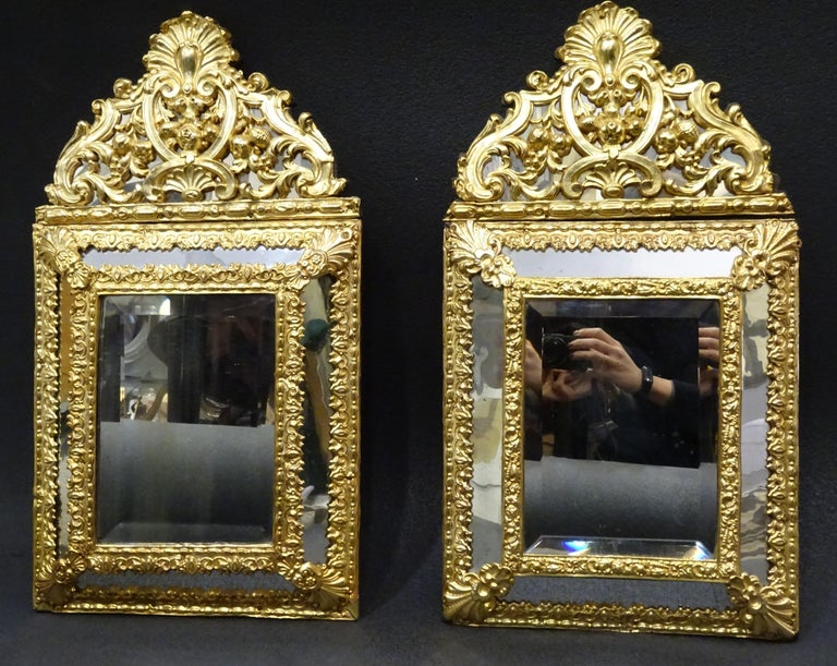 Outsunning pair of Dutch mirrors in gilt worked metal with fine gold on wood. The mirrors have fruity Pompadour and two mirrored corridors.