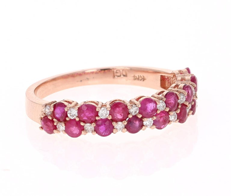 Cute and dainty Ruby and Diamond band that is sure to be a great addition to anyone's accessory collection. There are 16 Round Cut Rubies that weigh 1.30 carats and 16 Round Cut Diamonds that weigh 0.60 carats. The total carat weight of the band is