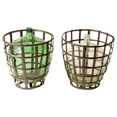 1900 French Metal Baskets with Bottles in Clear and Green Glass