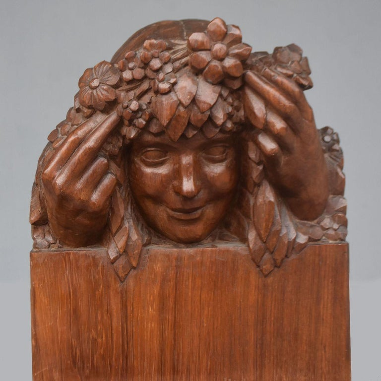 Head of a young girl with flowers Art Nouveau style 1900 period patinated wood.