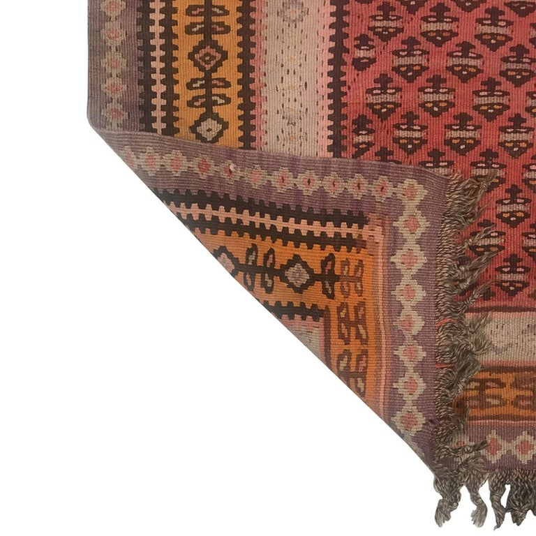 One-of-a kind vintage and antique Ghelims rugs, from Afghanistan, Turkey, Iran, Eastern and Central Asia. These historic rugs, woven between 1890 and 1950, have a contemporary flair for color, alongside their transitional and tribal patterns. Each