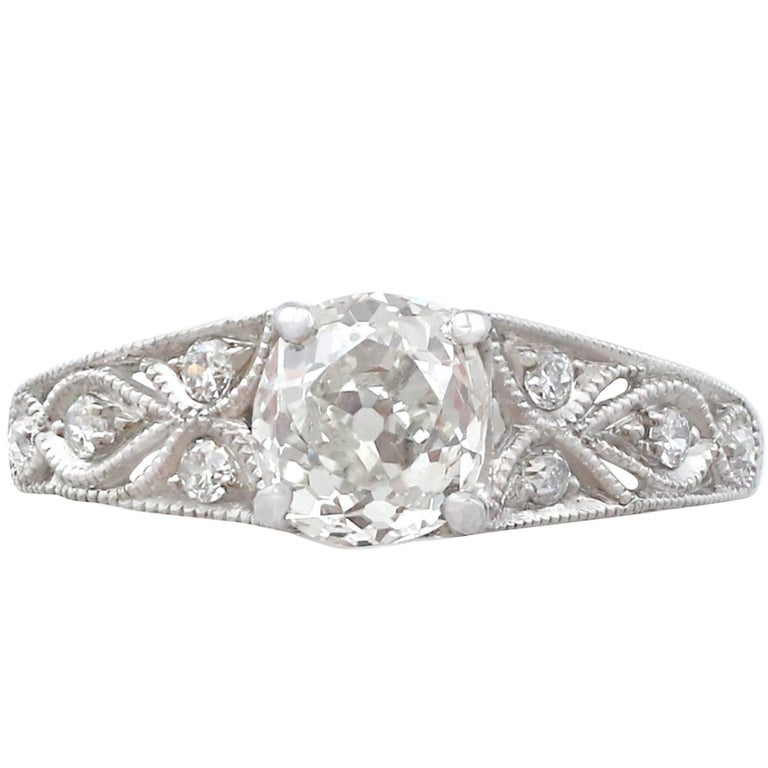 1900s 1.18 Carat Diamond and Contemporary Platinum Solitaire Ring