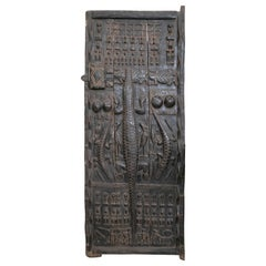 1900s African Wooden Door with Hand Carved Ethnic Human and Animal Relief