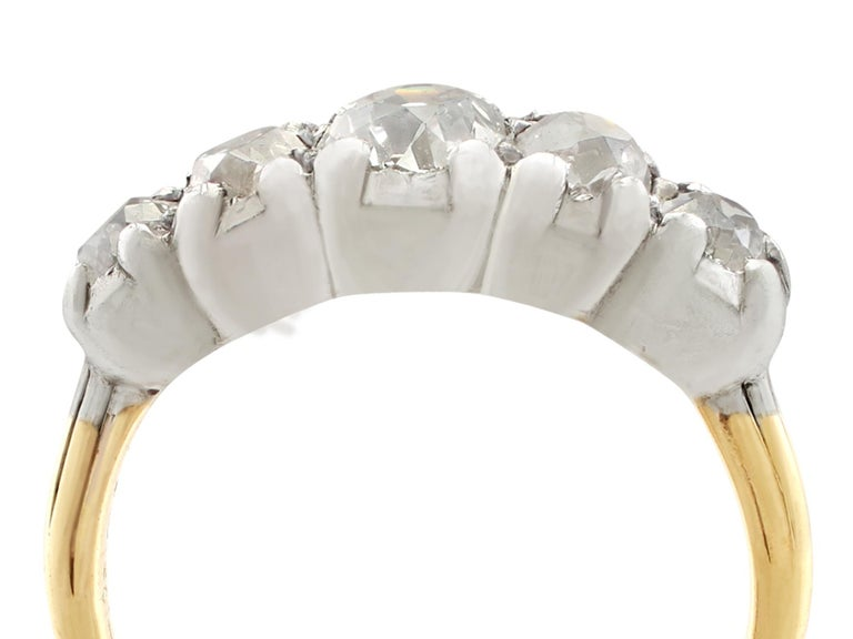 A fine and impressive antique 1.32 carat old European round cut diamond (total)and 14 karat yellow gold, 14 karat white gold set five stone ring; part of our diverse antique jewelry and estate jewelry collections  This fine and impressive five stone
