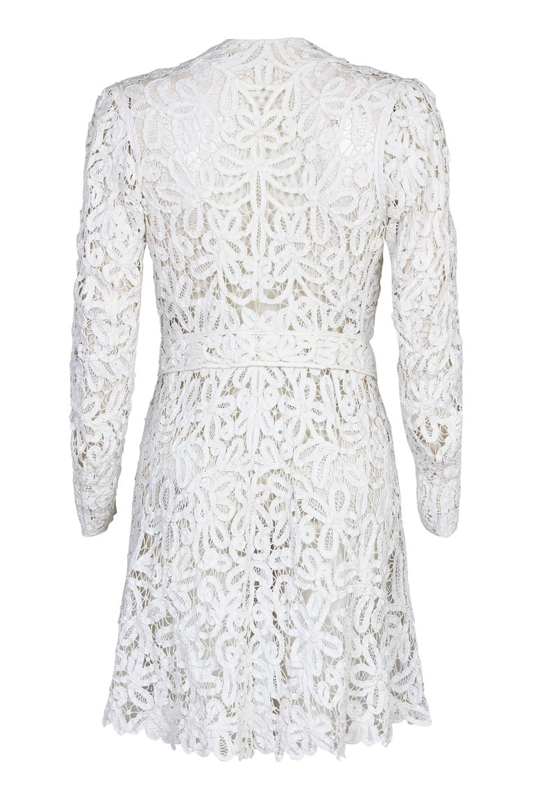 This exquisite 1900 - 1910s white battenburg or princess tape lace dress jacket is of exceptional quality and craftsmanship and is increasingly scare in this condition. The entire piece is made up of handmade tape lace, a unique style of lace-making