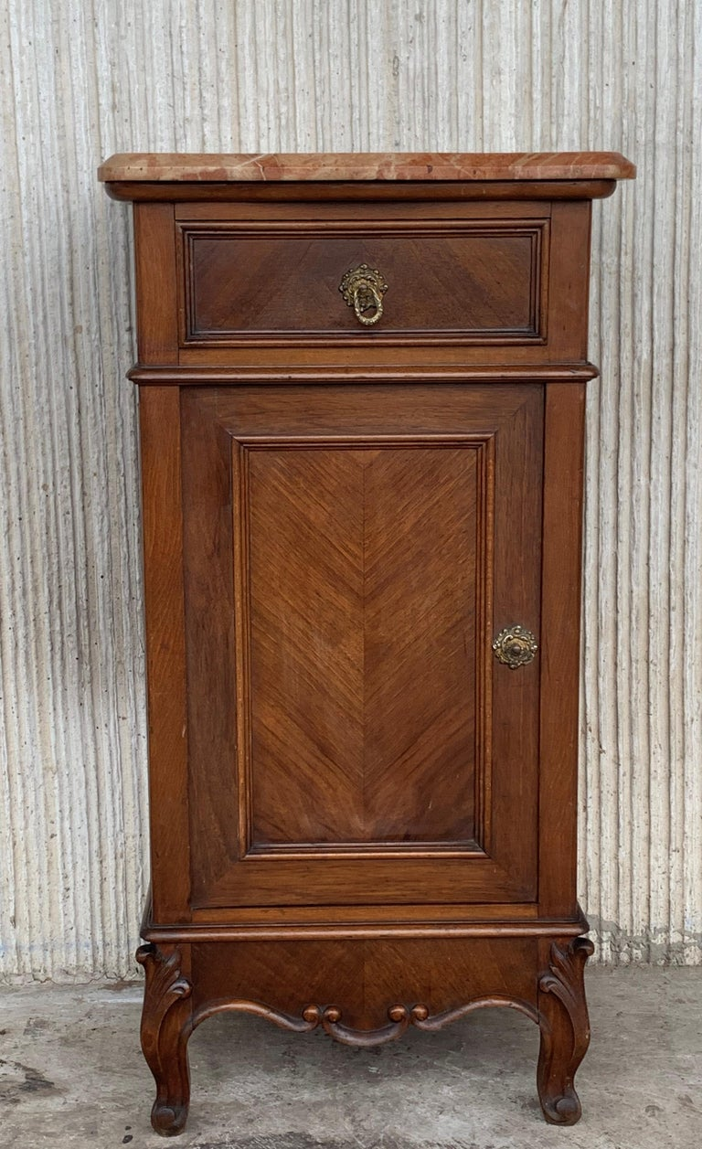 Late 19th century Art Nouveau pair of nightstands in walnut, bronze handles, restored and polished to wax.