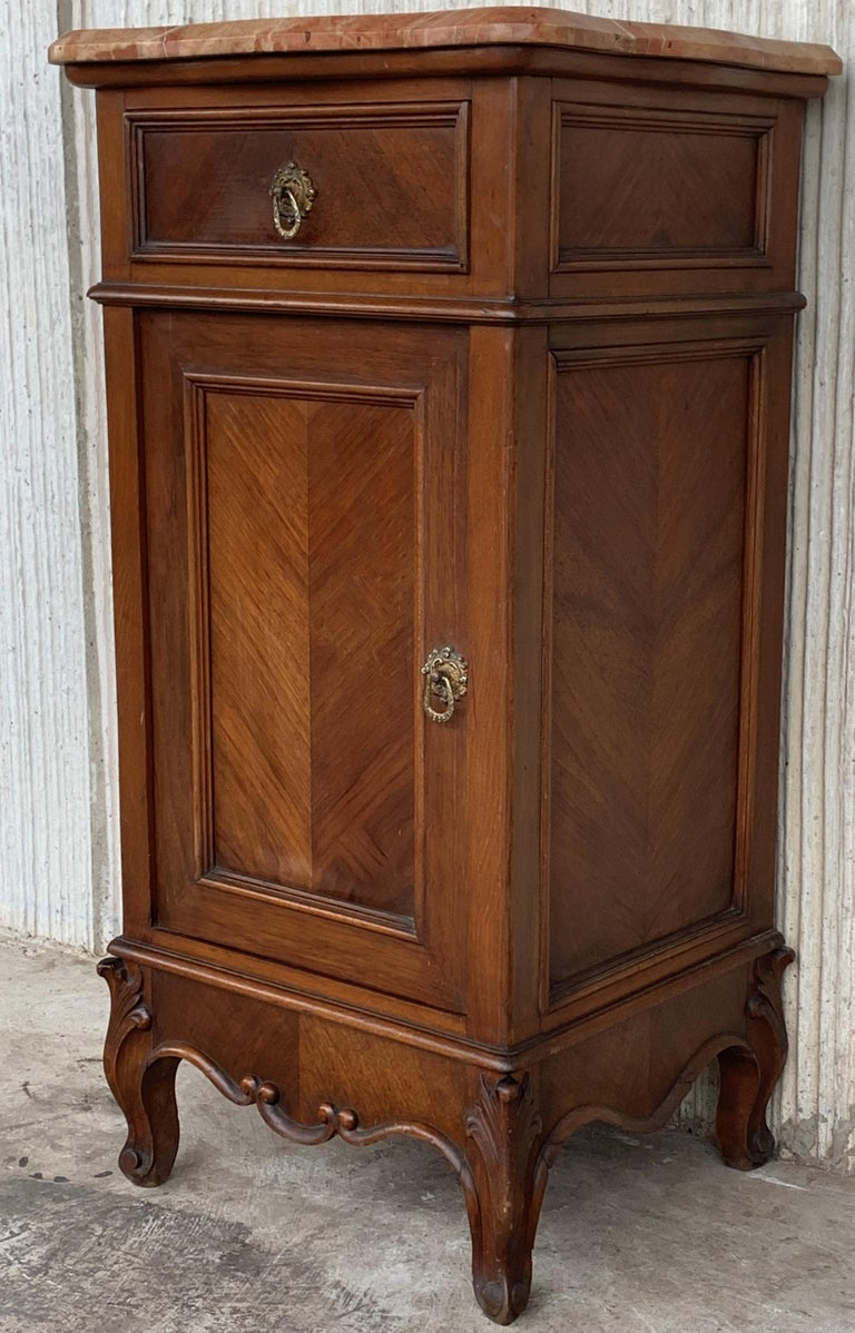 Spanish 1900s, Art Nouveau Pair of Walnut Nightstands with Crest and Marble Top For Sale