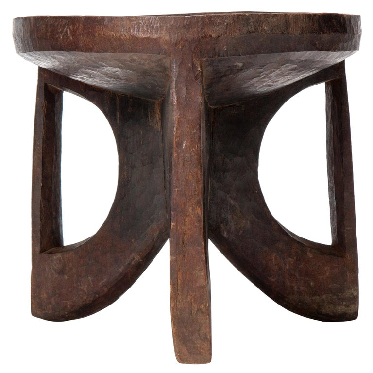 Carved tribal stool, 1900s, offered by WYETH