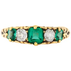 1900s Five Stones Emeralds with Diamonds Ring
