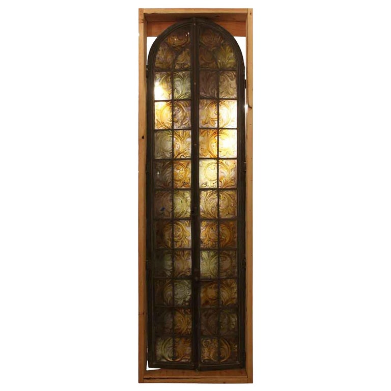 1900s Hand Painted Amber Arched Top Stained Glass Window in Bronze Frame For Sale