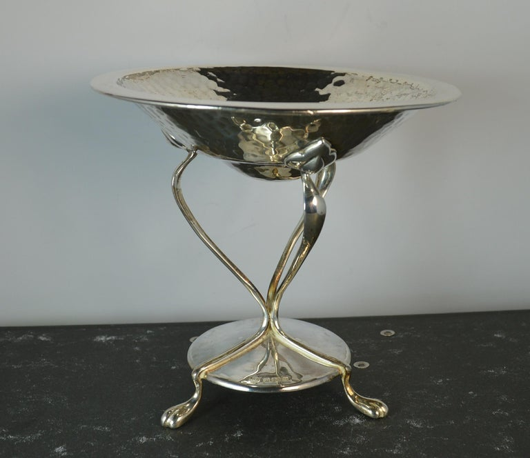 A very stylish comport or tazza. English hallmarked sterling silver example. Arts and crafts design with three feet on silver tubes and a hammered finish.  Hallmarks ; lion, Sheffield crown, date letter n and makers marks Size ; 12.5cm diameter,