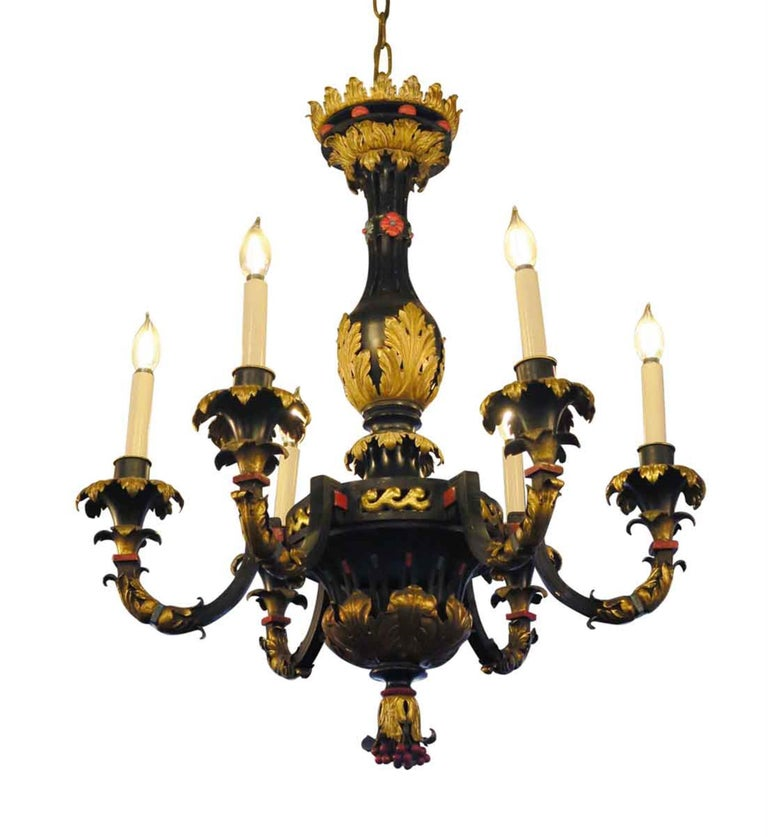 French made hand painted black, red and gold bronze and gilt metal six arm chandelier, decorated with berries and floral leaf motif. Circa 1905. This can be seen at our 2420 Broadway location on the upper west side in Manhattan.