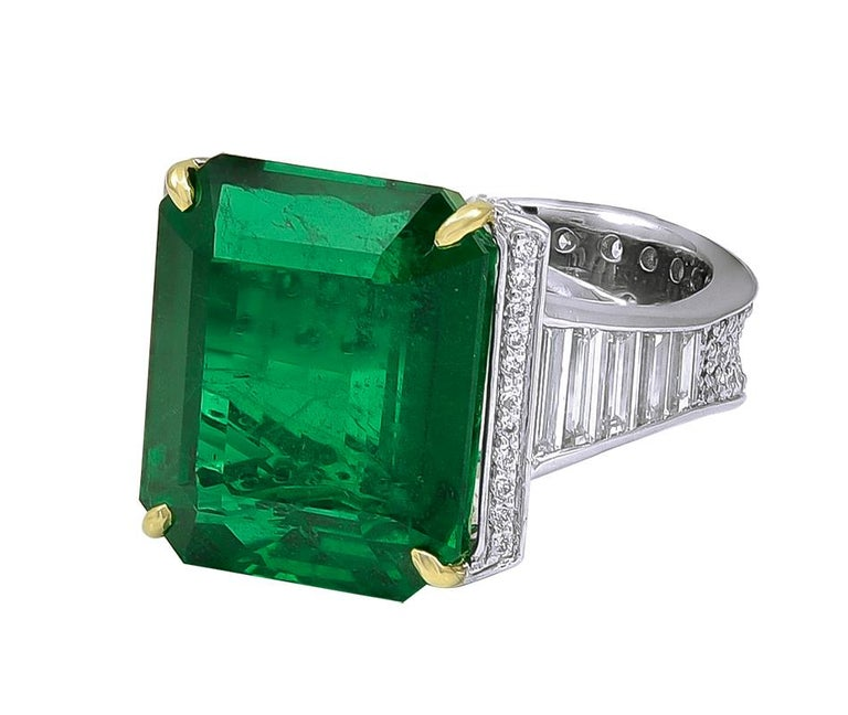 A majestic 19.09 Carat African Emerald and Diamond Ring. With white diamonds weighing 2.54 carats. This marvelous piece is set in Platinum material. The bottom shank measures 0.31
