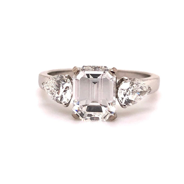 A beautiful French Diamond Ring with a very bright 1.91 carats emerald cut diamond of E VVS2 (GIA certified) and two pear-shaped diamonds of circa 1 carats. The combination of Emerald-cut and pear-shaped diamonds make it a very special and beautiful