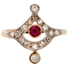 1910 .15 Carat Diamond, Ruby and Pearl Ring, 18 Karat Gold and Platinum