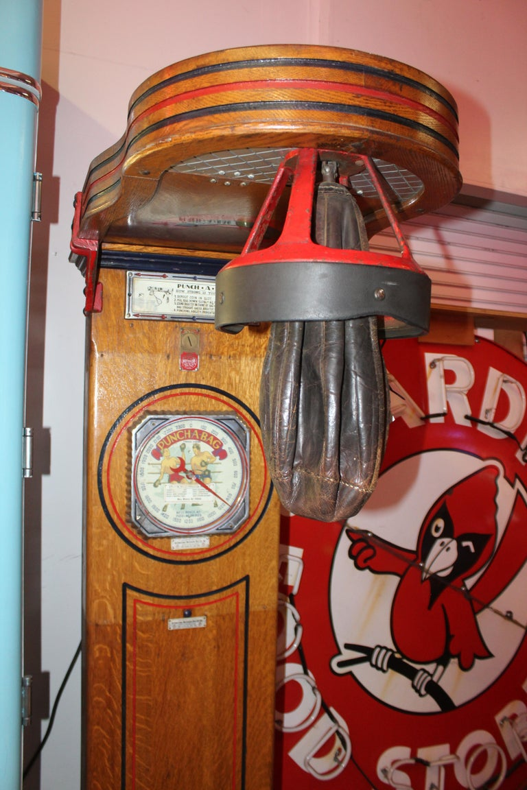 "1 cent Mutoscope ""Punch-A-Bag"" floor punching bag game strength tester arcade machine. This is more of a decoration piece or a great restoration project. It is not a working machine. Machine has some blemishes and wear. Also has a spot that dis"
