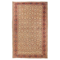1910 Antique Persian Sultanabad Rug with Navy & Red Floral Motif on Ivory Field