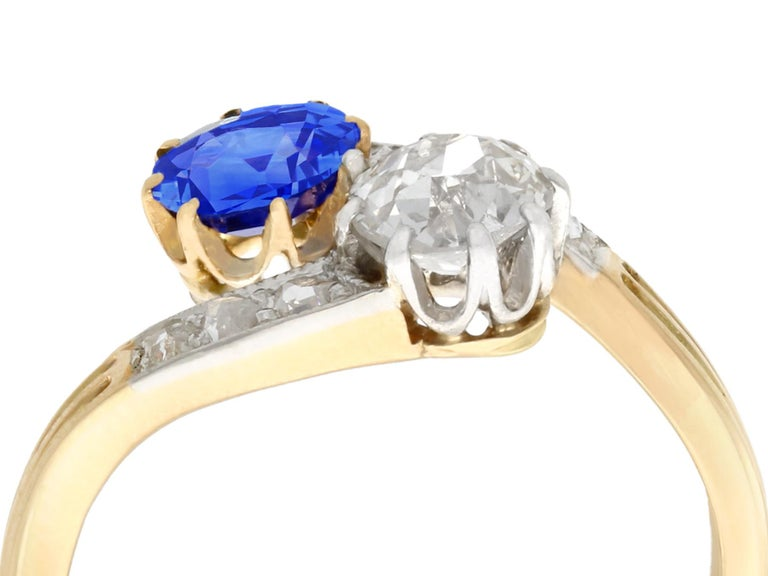 A stunning, fine and impressive antique 0.45 carat natural sapphire and 0.52 carat diamond, 14 karat yellow gold, 14 karat white gold set twist ring; part of our antique jewelry and estate jewelry collections  This stunning sapphire and diamond