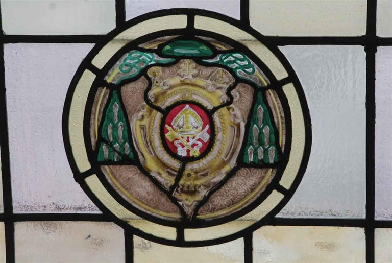 Wood framed 1910 Arts & Crafts stained glass window. Some stress cracks. This can be seen at our 400 Gilligan St location in Scranton, PA.