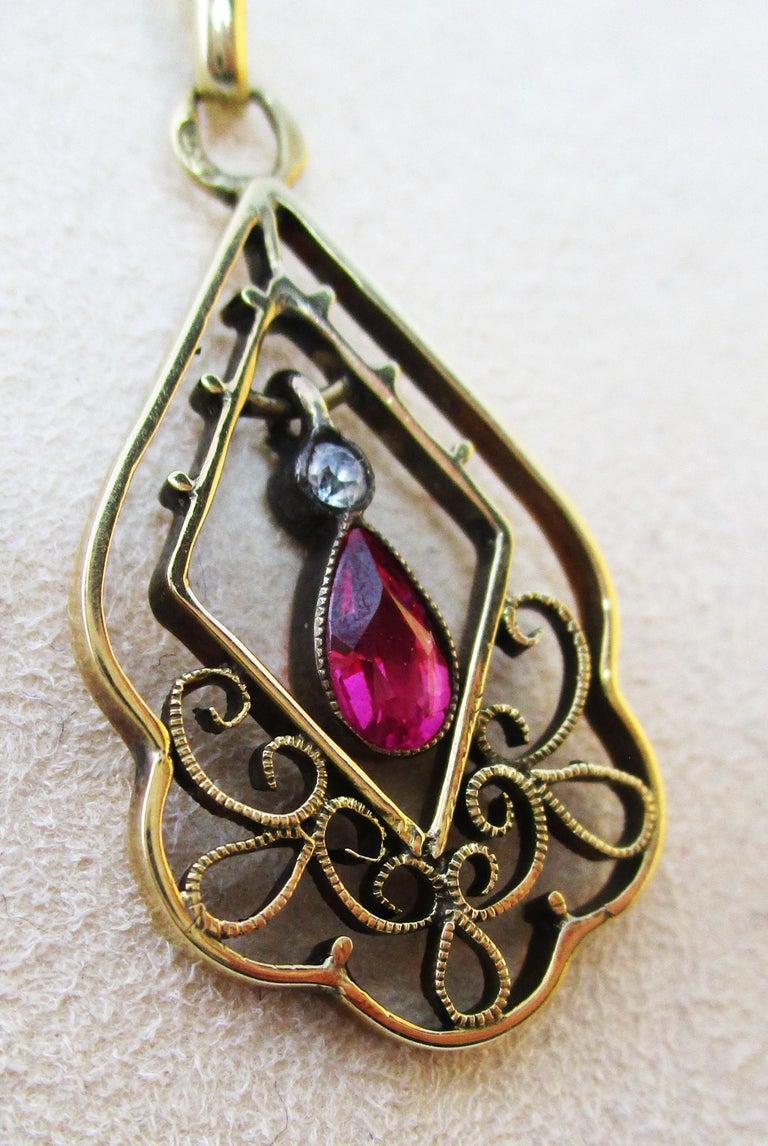 Pear Cut 1910 Edwardian Austrian 14 Karat Gold Ruby Diamond Pendant For Sale