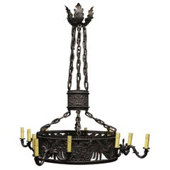1910 Gothic Hand Forged Wrought Iron Figural 12 Light Chandelier with Detailing