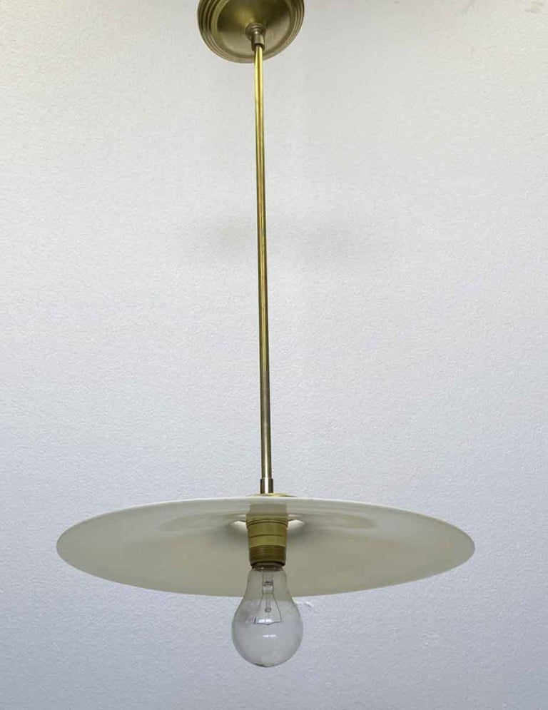 1910 Pancake Milk Glass Light Pendant Light with Brass Hardware In Good Condition For Sale In New York, NY