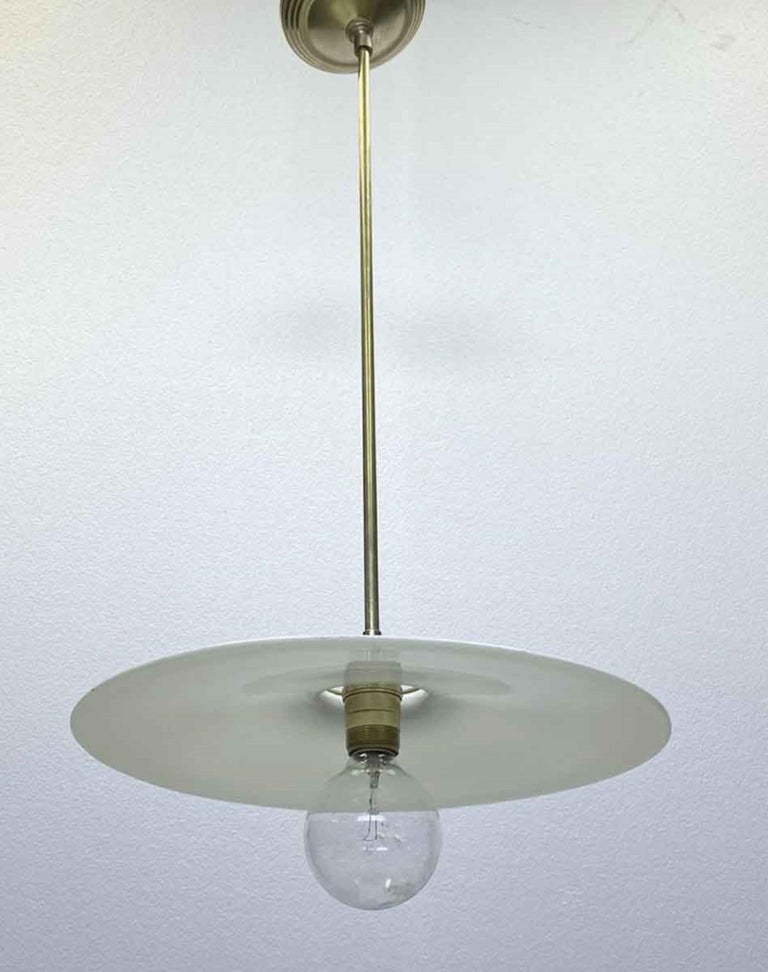 Early 20th Century 1910 Pancake Milk Glass Light Pendant Light with Brass Hardware For Sale