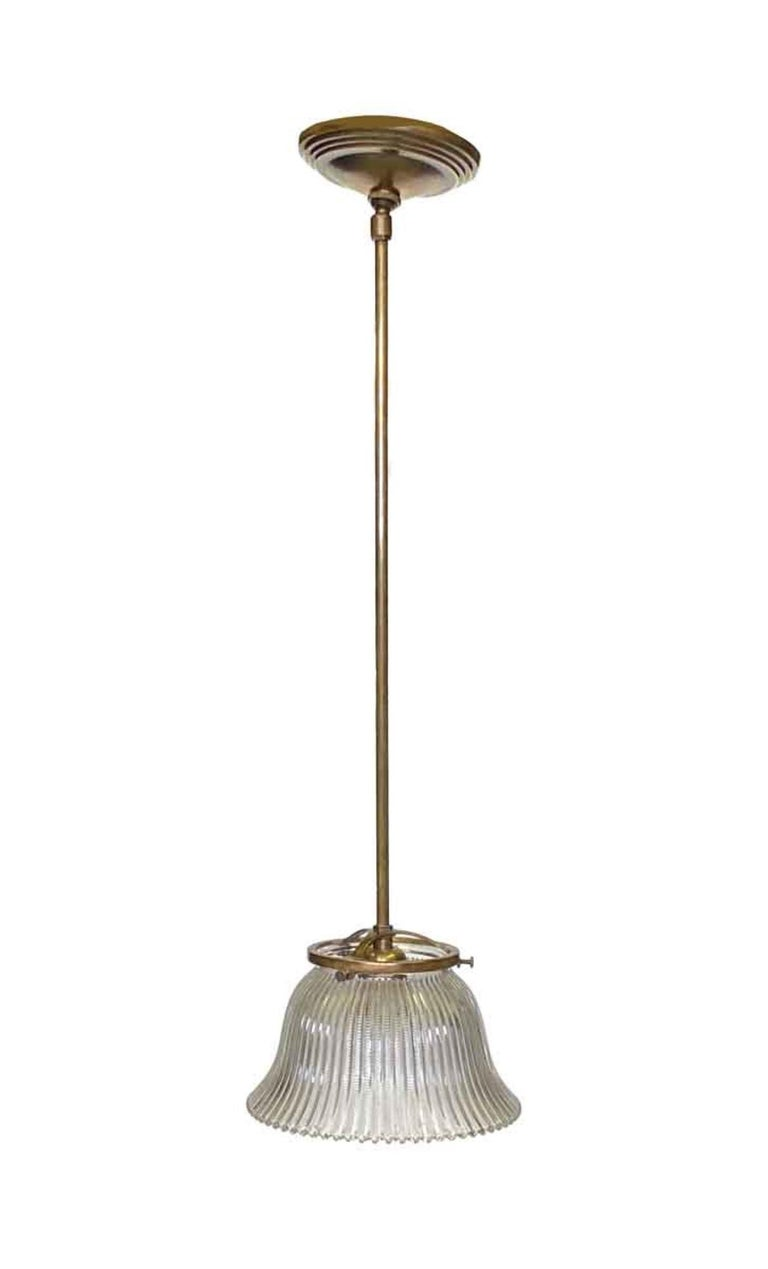 1910 Holophane glass shade used in gas lanterns that has been retrofitted to become a pendant ceiling light. Can be fitted with a brass fixture as pictured, or brushed steel. Priced each. Small quantity available at time of posting. Priced each.