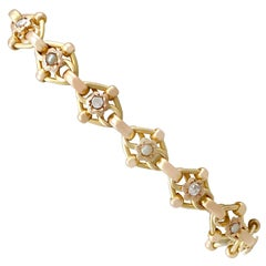 1910s Antique 2.61 Carat Diamond and Seed Pearl Yellow Gold Bracelet