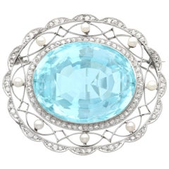 1910s Antique 43.84 Carat Aquamarine Diamond and Pearl Platinum Brooch